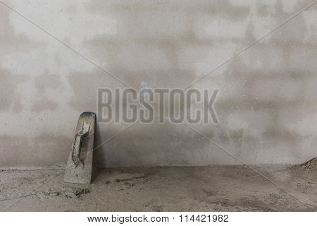 Cement Wall In Construction Site With Trowel Handheld Tool Used Spread Mortar Or Plaster
