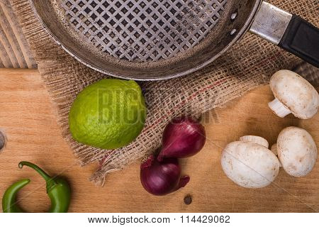 Lime And Pan With Vegetables