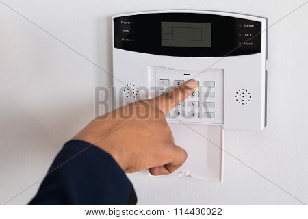Person's Hand Entering Code In Security System