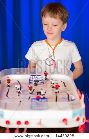 Boy Playing Table Hockey
