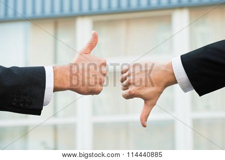 Businessmen Showing Like And Dislike Signs
