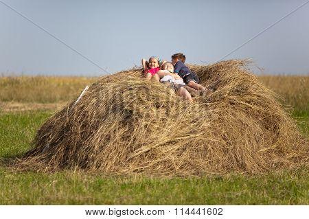 Children Resting In The Hay