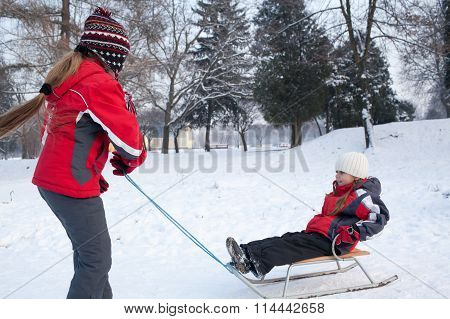 Children Having Fun In Winter Park