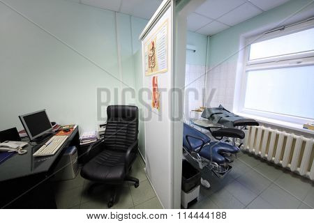 RUSSIA, MOSCOW - AUG 31, 2015: interior of exam room gastroenterologist with study poster about treatment of motor disorders of digestive tract on wall inside in Center Endosurgery and Lithotripsy