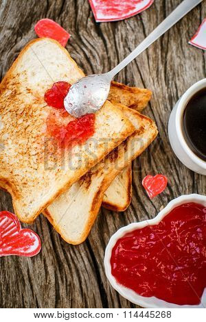 Toast With Strawberry Jam In A Heart Shape. Valentine's Day.