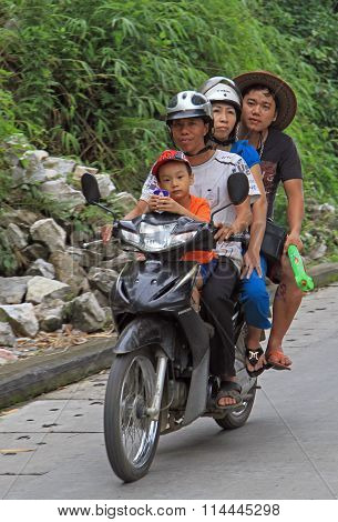 four persons are riding to somewhere by motorcycle