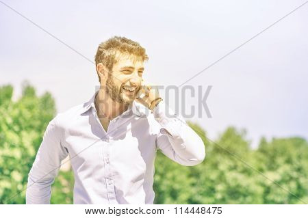 Happy Young Business Man At Park With Smartphone Having A Break After A Working Day - Modern Concept