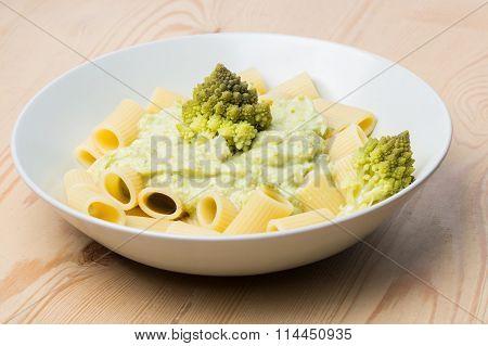 Pasta With Romanesco Broccoli Cabbage And Mozzarella. On Rustic Background.