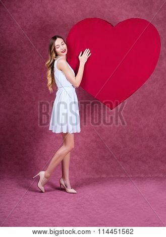 Elegant And Fashion Woman Holding Heart