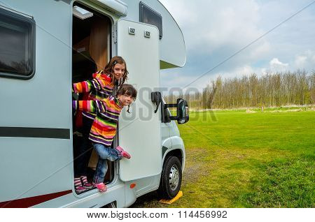 Kids in camper (rv), family travel in motorhome on vacation