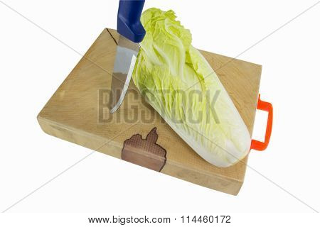 Knife And Chinese Cabbage On The Chopping Block