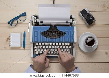 Hands on typewriter on the office desk