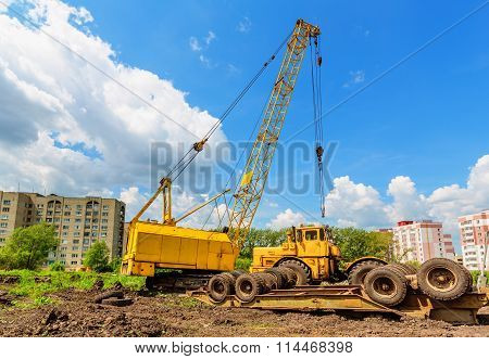 Mobile caterpillar crane on a background of blue sky