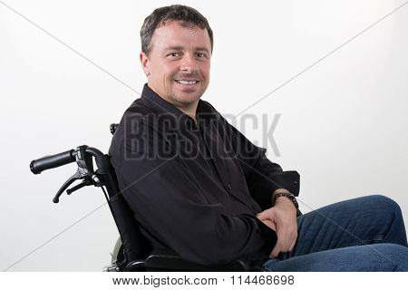 Man In A Wheelchair Isolated On White