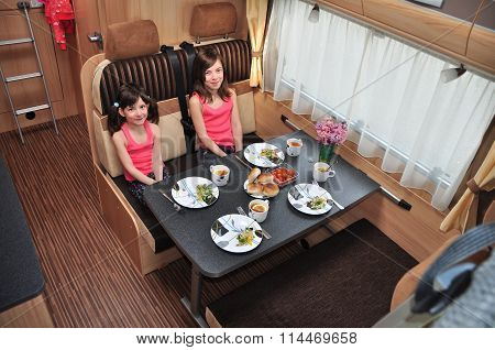 Family vacation, RV holiday trip, camping. Happy smiling kids travel on camper. Children eating