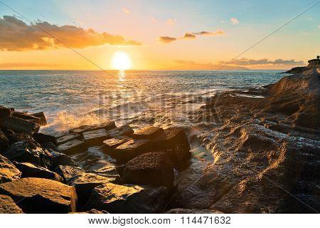 Rocks at topical beach at beautiful sunset.Costa Adeje, Tenerife, Spain