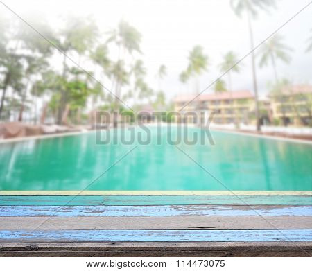 Wood Table Top Of Background And Pool
