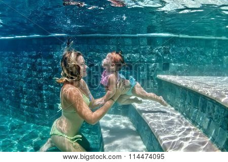 Mother With Child Swimming Underwater In Blue Beach Pool0