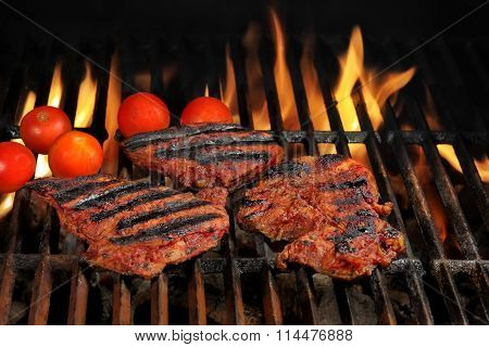 Beef Steaks On The Hot Bbq Grill With Bright Flames