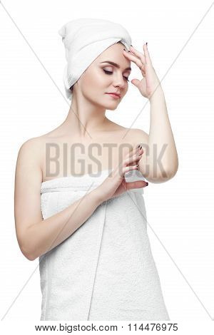 Young woman wrapped towel isolated white background. Woman Wearing White Bath Towel Drying Hair with