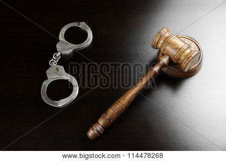 Real Judges Gavel And Handcuffs On The Black Table