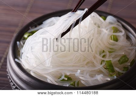 Glass Noodles With Green Onions In A Bowl Macro. Horizontal