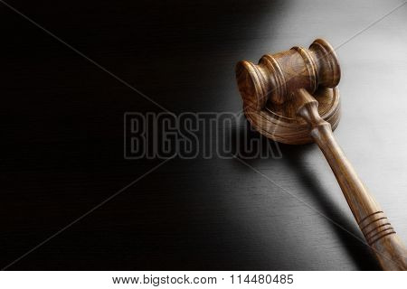 Judges Or Auctioneers Walnut Gavel On The Black Table