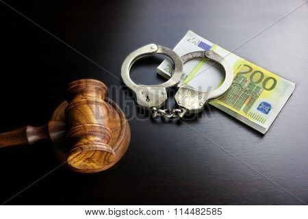 Judges Gavel, Handcuffs And Euro Cash  On The Black Table