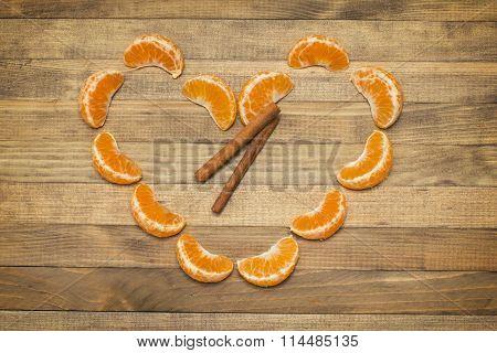 Two Stick Cinnamon And Heart Symbol Made Of  Segment Mandarin