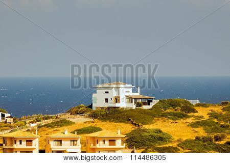 Beautiful house on top of a hill at Agious Apostolous in Evia Greece against the sea.