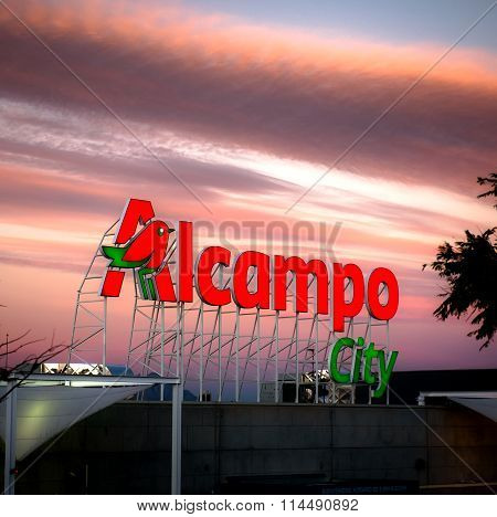 Alicante, Spain- January 12, 2016: Sunset Over Alcampo City Signboard In Alicante. Alcampo (auchan)