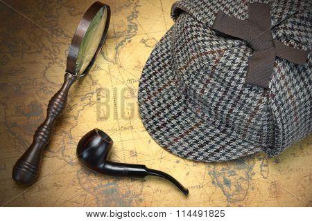 Deerstalker Hat, Magnifier And Smoking Pipe On Map.