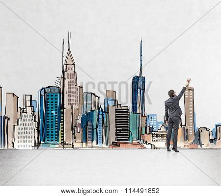 Man Painting New York On The Wall