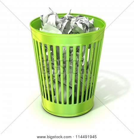 Green trash bin full of crumpled paper