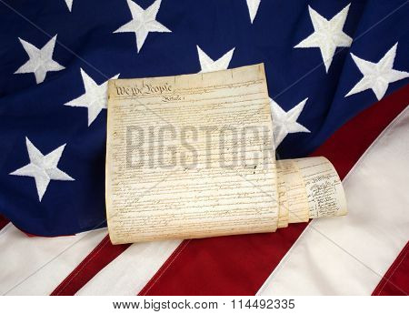 Rolled US Constitution on American Flag