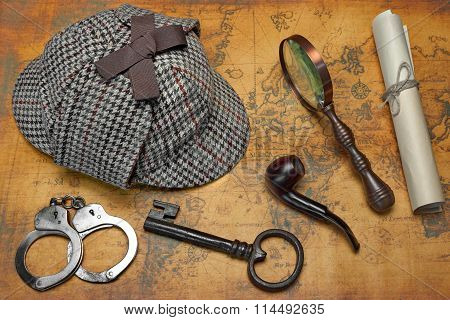 Overhead View Of Deersralker Hat And Detective Tools On Map