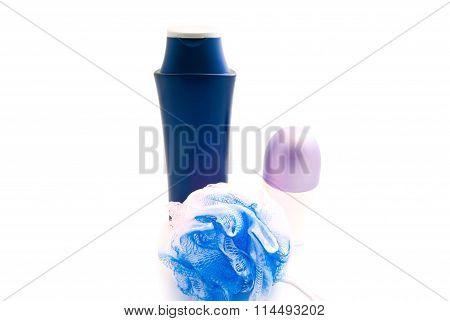 Deodorant, Wisp And Shampoo On White