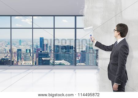 Businessman Covering Office View With Paint