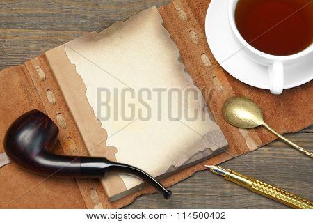 Opened Vintage Notebook With Blank Page, Pen, Teacup, Spoon, Pipe