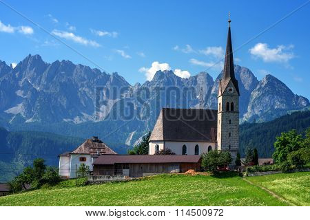 Christianity churh in Gosau village at sunny day. Alps, Austria, Europe.