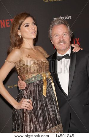 BEVERLY HILLS, CA - JAN. 10: Blanca Blanco and John Savage arrive at the Weinstein Company and Netflix 2016 Golden Globes After Party, Jan. 10, 2016 at the Beverly Hilton Hotel in Beverly Hills, CA.