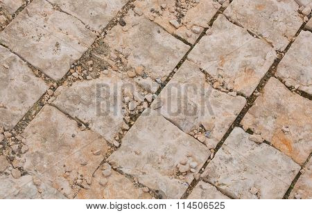 Destroyed decorative diagonal brick cladding. Closeup. Background