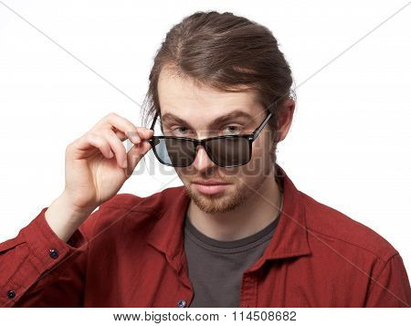 Young Man Looking Disparaging Over The Sunglasses