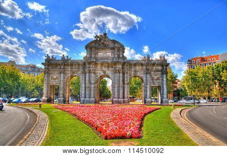 Colorful image of Puerta de Alcala (Alcala Gate) in Madrid Spain in HDR