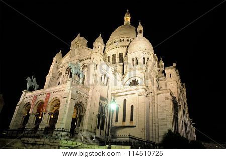 The front of the beautiful church Sacre Coeur in Paris at night