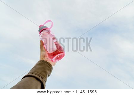 Female holding bottle of water