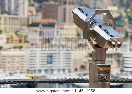Exterior of the coin operated binocular at the viewpoint with the urban panorama at the background i