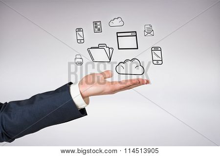 Hand presenting against grey background
