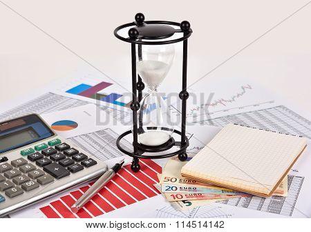 Sandglass And Business Charts