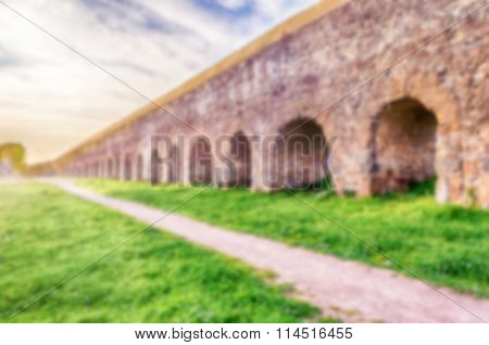 Defocused Background With Ruins Of Ancient Roman Aqueducts, Rome, Italy